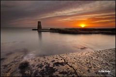 Souter Rangefinder at Dawn (Mike Ridley.) Tags: uk longexposure england orange sunlight water sunshine rock clouds sunrise coast rocks waves cloudy rangefinder coastal northsea coastline marsden whitburn northeastcoast souterlighthouse kood northeastengland canonef1740f4l neutraldensity graduatedfilter leefilters canon5dmkll fellwalker1 lee09ndhardgraduatedfilter koodnd4filter