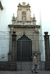 Catholic Church formal architectural side entrance, renaissance architecture with Spanish and Italian influences, ornate metal fence, man walking past, Guadalajara, Jalisco, Mexico (Wonderlane) Tags: church mexico catholic side formal entrance guadalajara jalisco architectural shade keyhole sideentrance wonderlane 7184 renaissancearchitecture manwalkingpast ornatemetalfence