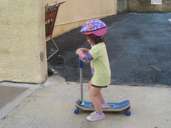 Speck on new skateboard, with helmet and elbow pads
