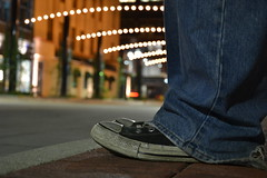 Night Life (ashleyhancockphotography) Tags: road street city boy blur feet night lights downtown bokeh converse chucktaylors allstars 18105mm nikond3100