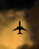 Unfriendly Skies (cormend) Tags: sky tourism silhouette clouds america plane canon airplane puerto island eos puertorico flight center tourist rico american tropical caribbean centered dc10 50d cormend