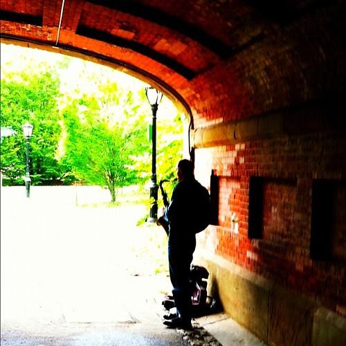 Saxophone busker under Driprock Arch