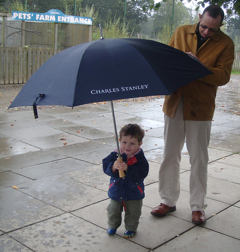 Wee boy, big umbrella, wet Grandad