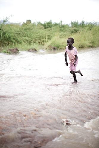 Girl running on flooded road