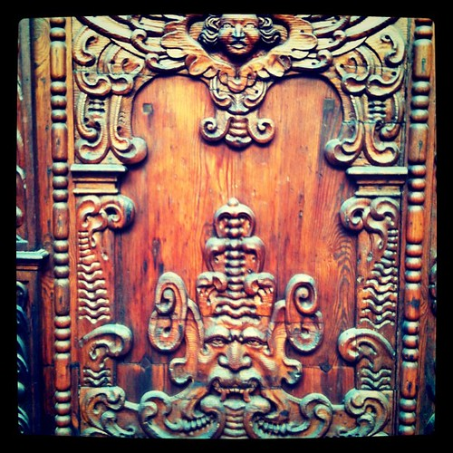 Intricately carved old door in Strasbourg