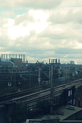My Lnd (til01) Tags: london uk unitedkingdom greatbritain bethnalgreen east e2 train yard cables city town rain clouds bricks
