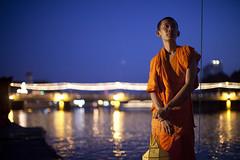 Monk On River (asiastories) Tags: holiday water festival river thailand evening asia southeastasia glow buddhist prayer religion monk buddhism chiangmai lantern northernthailand