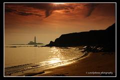 IMG_0060 (scotchjohnnie) Tags: sea sky sun sunlight lighthouse silhouette photoshop sunrise canon rocks northsea headland whitleybay tynewear stmaryslighthouse oldhartley scotchjohnnie