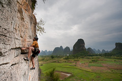 Ahad Sabet Climbing Eggstatic 5.11c (Amicus Telemarkorum) Tags: china green rock clouds october yangshuo egg september climbing climber karst 2011 rockclimber ahadsabet eggstatic jeffrueppelphotography egg511c