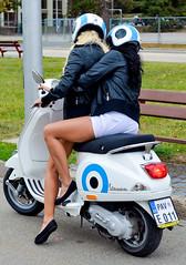 Vespa girls (The Adventurous Eye) Tags: girls woman girl nikon women vespa d hostess 7000 d7000