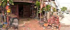 ร้านซ่อมรถในตลาดเมืองชล