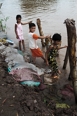 By the dyke (nguyenphuocloc_1958) Tags: bridge fish water swim children boat jump cu bi nhy cuc chothuyn ihc btc ncni