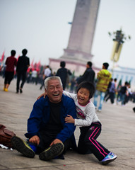 Boy and Grandfather at Tiananmen Square (Stuck in Customs) Tags: china city travel family man monument smiling digital laughing square fun happy person photography blog high october hug focus gate asia republic child dynamic stuck symbol bokeh candid wrestling beijing content icon east photoblog software processing metropolis imaging  prc forbiddencity bonds tiananmensquare northern range tiananmen hdr tutorial trey peking outing bonding travelblog customs 2010 municipality gateofheavenlypeace bijng ratcliff northernchina hdrtutorial stuckincustoms treyratcliff photographyblog peoplesrepublicofchina stuckincustomscom nikond3s