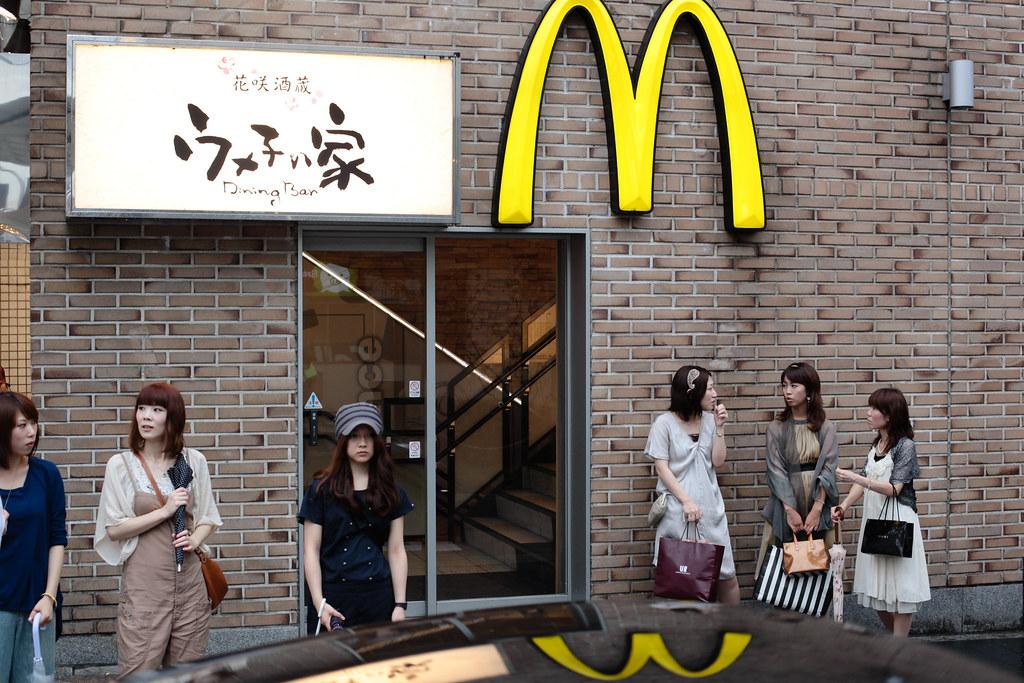 Girls in evening dresses under McD sign in Kawaramachi, Kyoto