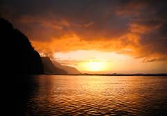 Sunset (www.AlastairHumphreys.com) Tags: ocean sunset summer sky sun mountain holiday beach water dark hawaii warm waves moody tropical
