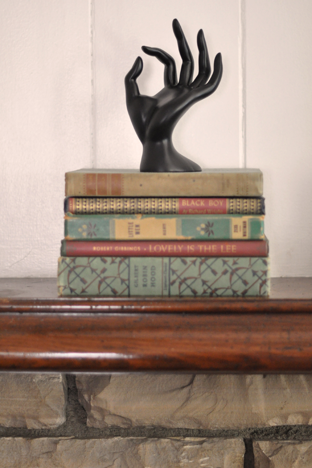vintage books- black hand sculpture-hand decoer-halloween decorating