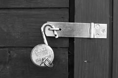 Unlocked (jepoirrier) Tags: door plaza bw white black 50mm freedom key lock unlock padlock unlocked 25p 7levers