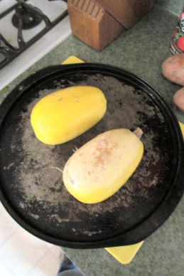 Spaghetti Squash Face Down on Oiled Baking Sheet