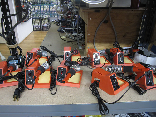 a bunch of shiny new soldering irons