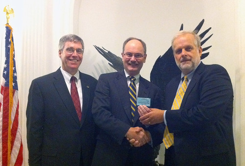 Roger Baker receiving VIP Underground Railroad Card from Tom Munnecke; Peter Levin looks on