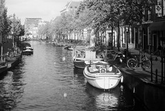 (k.dmitrijewa) Tags: summer bw holland film netherlands dutch bicycle boats canal europe nederland eu paysbas timeless niederlande gracht fed3 hollandia holandia pasesbajos  alankomaat nizozemska pennyjey