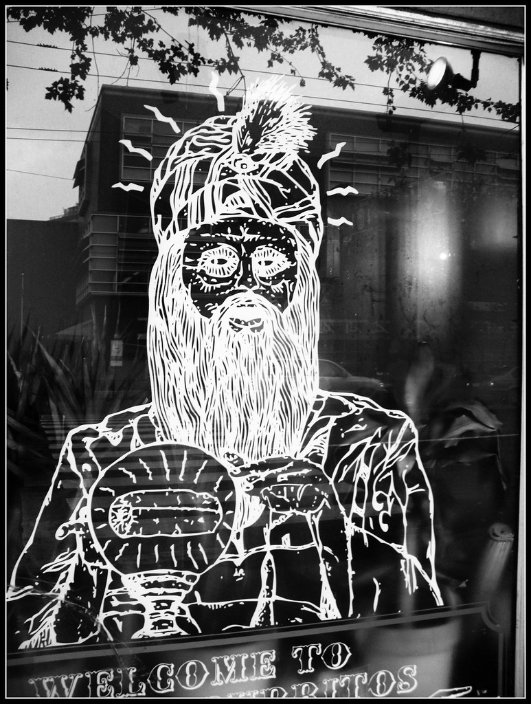 drawing of a guru or psychic on window