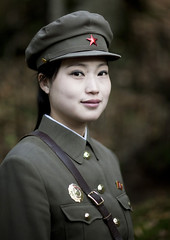Revolutionary site of Chongbong guide - North Korea (Eric Lafforgue) Tags: woman cute girl beauty smile face soldier army asia korea cap asie guide coree northkorea redstar dp