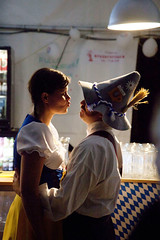 Festival of Arctic kisses  Rob Watkins (Aland Rob) Tags: street woman man cute love beer girl hat norway festival loving bar night high kiss kissing funny couple candid feather kisses skirt lips svalbard arctic clothes photograph 5d moment embrace spitsbergen pucker bavarian mark