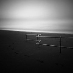 Something In The Way (Andy Brown (mrbuk1)) Tags: ocean longexposure cloud mist seascape beach water lines fog fence square mono coast blackwhite sand contemporary shoreline footprints minimal devon railings zigzag teignmouth doesmyarselookbiginthis