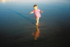 matilda enjoying indian summer (lomokev) Tags: shadow sea portrait reflection beach wet smile laughing happy sand toddler brighton child mju running olympus lowtide agfa ultra goldenhour agfaultra wetsand olympusmju olympusmjuii deletetag olympusmju2 matildameredith posted:to=tumblr file:name=110930olympusmjuiiagfaultra10edit roll:name=110930olympusmjuiiagfaultra