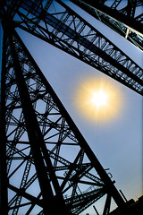 Sun and the Transporter Bridge. (CWhatPhotos) Tags: pictures above bridge blue sun sunshine metal work canon river that lens eos photo skies foto shine with image zoom photos picture images have fotos frame dslr middlesbrough which skys span girders contain girder cradle tees containing 18200mm cwhatphotos 7dtransporter