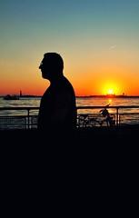 History | Life | Journey (Lanamaniac) Tags: city nyc sunset urban ny man water bike bicycle silhouette liberty nikon dusk manhattan stranger historic statueofliberty nikkor d90 lanamaniac