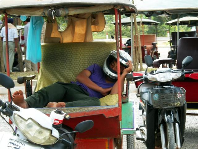 Sleeping Tuk-Tuk driver