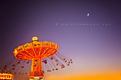 { swing baby, swing } (annie.manning {paint the moon}) Tags: carnival twilight swings amusementpark orangesky purplesky photoshopactions paintthemoonactions