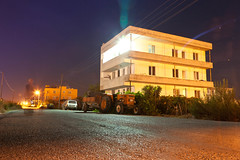 Central Asia Lite, Dalaman (flatworldsedge) Tags: lighting street longexposure tractor tarmac night turkey vines apartment farm cables flare ghosts telegraph turkfiat dalaman mugla