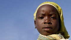 I am the future. (markjeremy) Tags: africa blue portrait sky yellow scarf children child bluesky malawi future generation yellowscarf warmheartofafrica