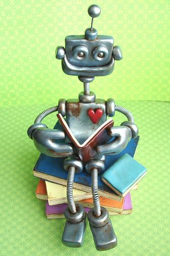 Ryan the Rustic Robot Reading | Robot Sculpture by HerArtSheLoves