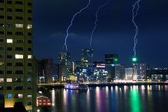 Lightning Strikes Not Once But Thrice (Bart van Damme) Tags: bridge summer urban sun reflection industry water netherlands colors beautiful lines bicycle river boats mirror sketch rainbow rotterdam raw colours harbour drawing ships sketching thenetherlands bluesky cranes shore badge bible montevideo buckminsterfuller maas kopvanzuid chemtrails meuse geodesicdome meccano laspalmas dehef wilhelminapier brienenoordbrug katendrecht rijnhaven rivermeuse skylinerotterdam codrico rotterdamskyline maastoren benthemcrouwelarchitects cite rotterdamclimateinitiative erasmusbrugunstudio cornflourindustries kpnbuildingrenzopiano 1989mecanoo tangramarchitecten inhollandegeraat derotterdamremkoolhaasoma montevideomeccano dampartnersarchitecten neworleansbyalvarosizaarchitects laspalmasbybenthemcrouwelarchitects johnkormeling rotterdamclimateproof deltasyncpublicdomainarchitects citebytangramarchitects