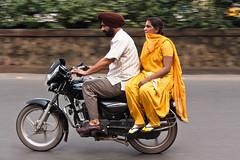 Sikh, Wife and Motorcycle (1969cw) Tags: street people yellow candid strasse gelb sikh panning kolkata indien motorrad westbengal ind kalkutta mitziehen