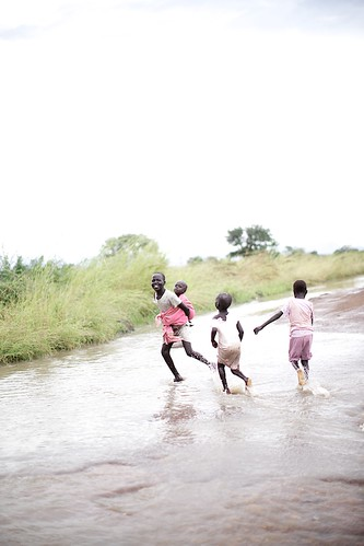 Children playing on flooded road