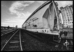 Factory (BHagen) Tags: sky urban blackandwhite bw cloud black abandoned industry train graffiti washington nikon spokane factory y cloudy grunge negro border tracks gritty fisheye d90 whiteblanco prooptic