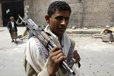 A Yemeni armed anti-government protester holds his gun in the Al Hasba neighborhood of Sanaa on September 29, 2011. Heavy clashes rocked northern neighborhoods of Yemen's capital. by Pan-African News Wire File Photos
