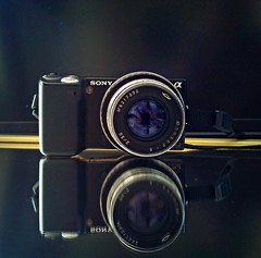 New old toy (just a lens) (maistora) Tags: leica blue light black reflection mobile self dark lens cards 50mm prime mirror tv phone purple upsidedown quality background sony sonyericsson cellphone fast double reflected soviet adapter resolution setup f2 jupiter process russian postprocess coated bravia android edit compact lightroom x10 lr3 jupiter8 nex coating m39 interchangeable mirrorless maistora 8 xperia nex5