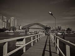 An oldie, but a goodie (Willieozify) Tags: city shadow sepia pier boat yacht jetty lamppost boardwalk vignetting 43 sydneyharbourbridge cotcpersonalfavorite oldiebutgoodie