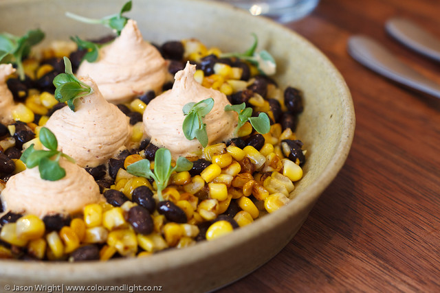 warm salad of sweetcorn, black beans w chipotle & lime creme fraiche