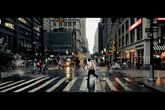 Rain & Steam (Dj Poe) Tags: street new york city nyc light people cinema ny wet rain bicycle umbrella canon photography eos dj crossing mark manhattan district candid steam ii 5d lower cinematic financial poe available 2011 5dmkii 5dmk2 carlzeissdistagont1435ze