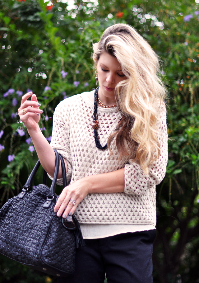 waved hair -open knit ivory sweater -woven leather bag -vintage necklace