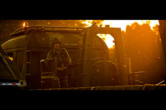 Soldier of Bokeh (Jeff Krol) Tags: from light sunset sun sunlight cinema trooper man backlight truck canon soldier army eos you photos bokeh crane or military special falcon flare controller cinematic hoogeveen defense f28 mosquitoes leger anamorphic 70200mm oefening 70200l xview landmacht ef70200mmf28lusm echten 60d defensie jeffkrol falconautumn landmachtlegerechtenhoogeveenoefening falconautumn2011 everyoneautumn