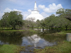 Anuradhapura (simo2582) Tags: world travel trees wild panorama lake reflection tree travelling water pool statue clouds reflections landscape temple freedom pagoda nice reisen asia view place earth buddha stupa buddhist flag religion ngc nowhere free buddhism flags holy reflected sri lanka oriente ceylon meditation wilderness orient spiritual potala riflessi blick reise anuradhapura dagoba buddismo ruvanvalisaya earthasia