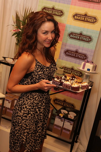 Erin Karpluk holds Baker Street cupcakes